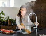 Quooker Flex girl cooking pasta landscape